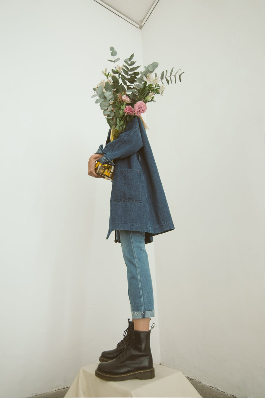 gray coat and blue jeans