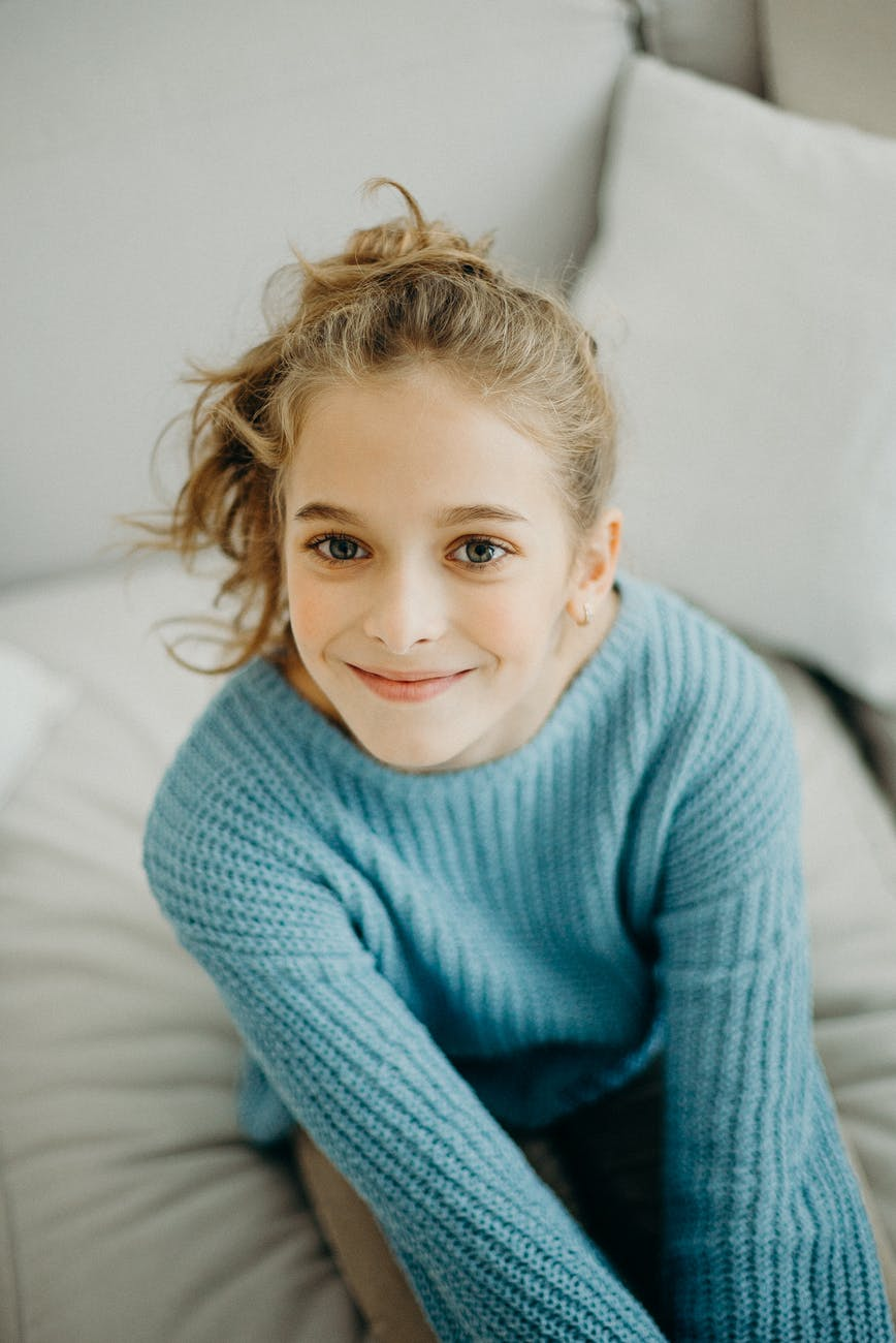 photo of a girl wearing blue sweater